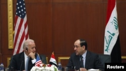 Iraqi Prime Minister Nuri al-Maliki (right) with U.S. Vice President Joe Biden in Baghdad on November 30.