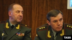 Russia -- General Valery Gerasimov (R), chief of the Russian General Staff, and Lieutenant General Igor Sergun, identified as head of the Russian military intelligence agency (GRU), May 3. 2012