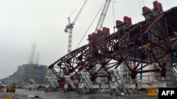 The first section of a colossal, arch-shaped structure that will cover the exploded reactor at the Chornobyl nuclear power station in Ukraine.
