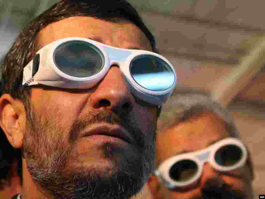 Iranian President Mahmud Ahmadinejad visits a laser technology exhibition in Tehran.