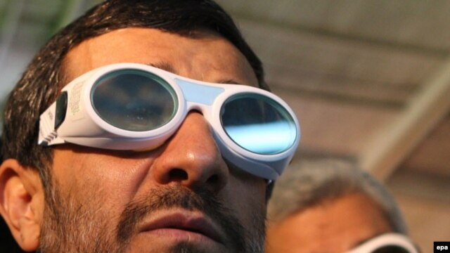 President Mahmud Ahmadinejad visits a technology exhibition. Western governments fear that his regime is developing nuclear weapons.