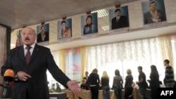 Belarus President Alyaksandr Lukashenka speaks to journalists after casting a ballot in Minsk in the September 23 voting.