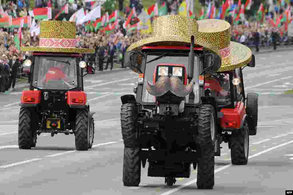Belarusian tractors take part in a parade during events marking Independence Day on July 3 in Minsk. (AFP/Sergei Gapon)