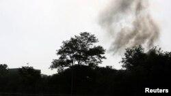 Облако дыма над местом взрывов в центре Кабула. 25 июня 2013 года.