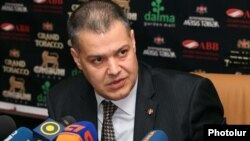 Armenia - Davit Harutiunian, chairman of the parliament committee on legal affairs, at a news conference.