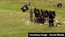 FILE: Grab from a video that shows militants loyal to the Islamic State (IS) blowing up bound and blindfolded Afghan prisoners with explosives. The victims were from Nangarhar Province. IS released the video in August 2015.