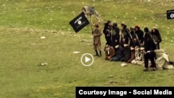 Grab from a video that shows militants loyal to the Islamic State (IS) blowing up bound and blindfolded Afghan prisoners with explosives. The victims were from Nangarhar Province (undated.