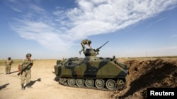 Армия Турции стягивается к сирийской границе