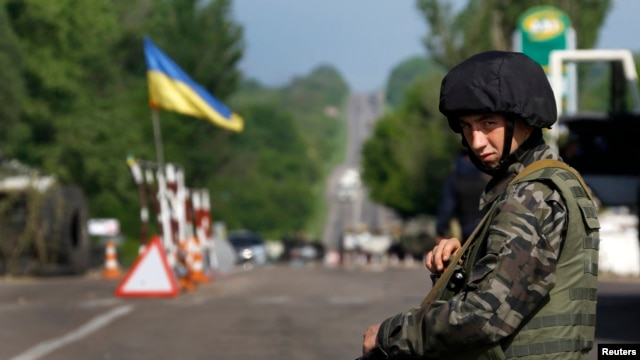 A Ukrainian Army soldier mans a roadblock north of the eastern town of Slovyansk.