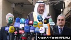 أمين عام منظمة التعاون الاسلامي أياد مدني يتحدث في مؤتمر صحفي في النجف