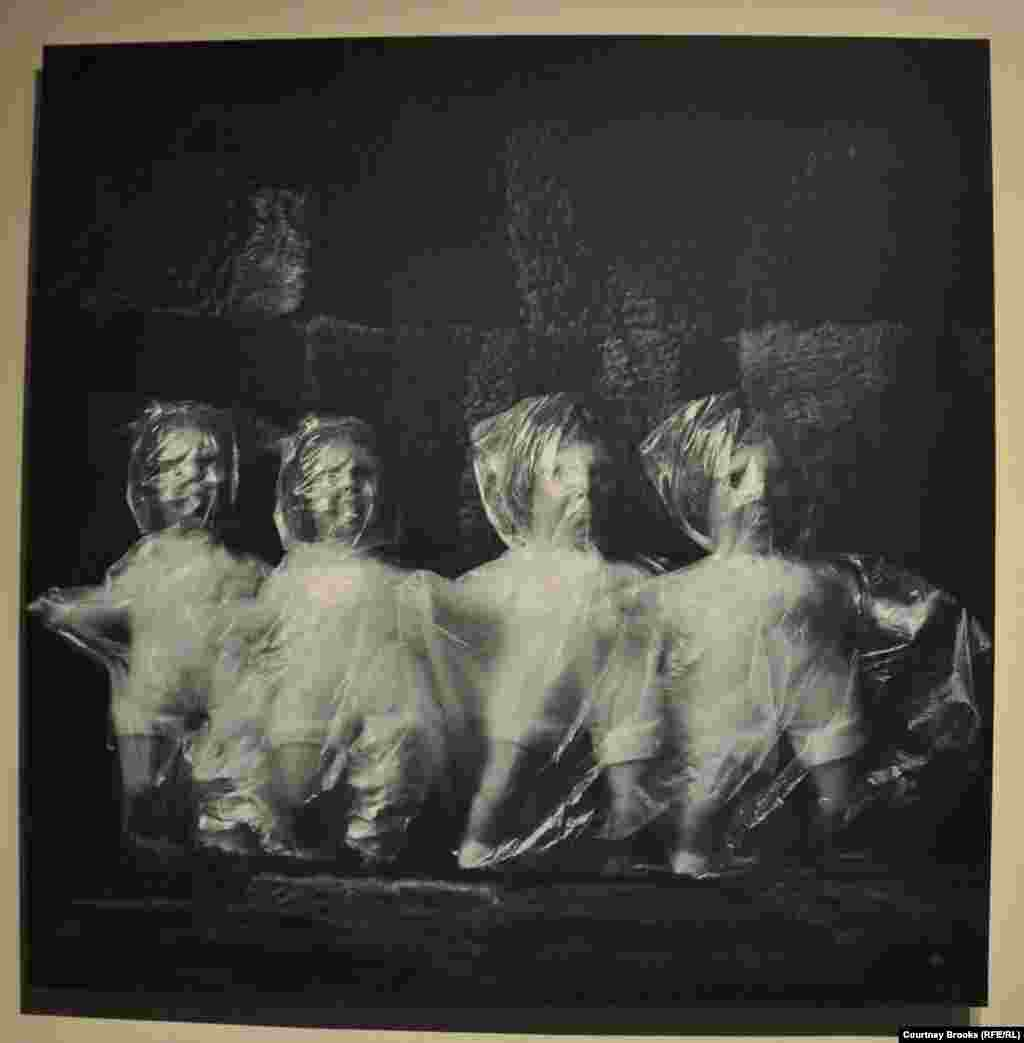 Four dolls are wrapped in plastic bags.