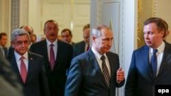 Russia -- Russian President Vladimir Putin (front C), Armenian President Serzh Sargsyan (L), Azerbaijan's President Ilham Aliyev (2-L) walk during their meeting in St. Petersburg, Russia, 20 June 2016.