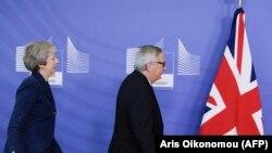 Британский премьер Тереза Мэй и глава Еврокомиссии Жан-Клод Юнкер