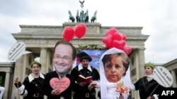 Активисты неправительственных организаций в Германии подготовились к визиту нового французского президента в Германию