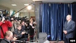 President Alyaksandr Lukashenka talks to media after voting in Minsk