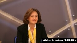 "Irina Lagunina in the studio hosting ""Free Talk."""