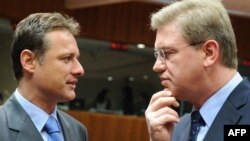 EU Enlargement Commissioner Stefan Fuele (right) speaks with Croatian Foreign Minister Gordan Jandrokovic before the seventh meeting of the EU-Croatia Stabilization and Association Council in Brussels on April 19.