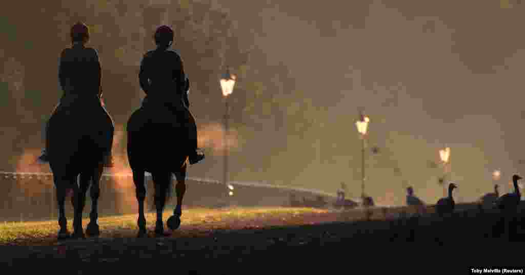 Horse riders on an early-morning morning jaunt in Hyde Park, London, on September 20. (Reuters/Toby Melville)