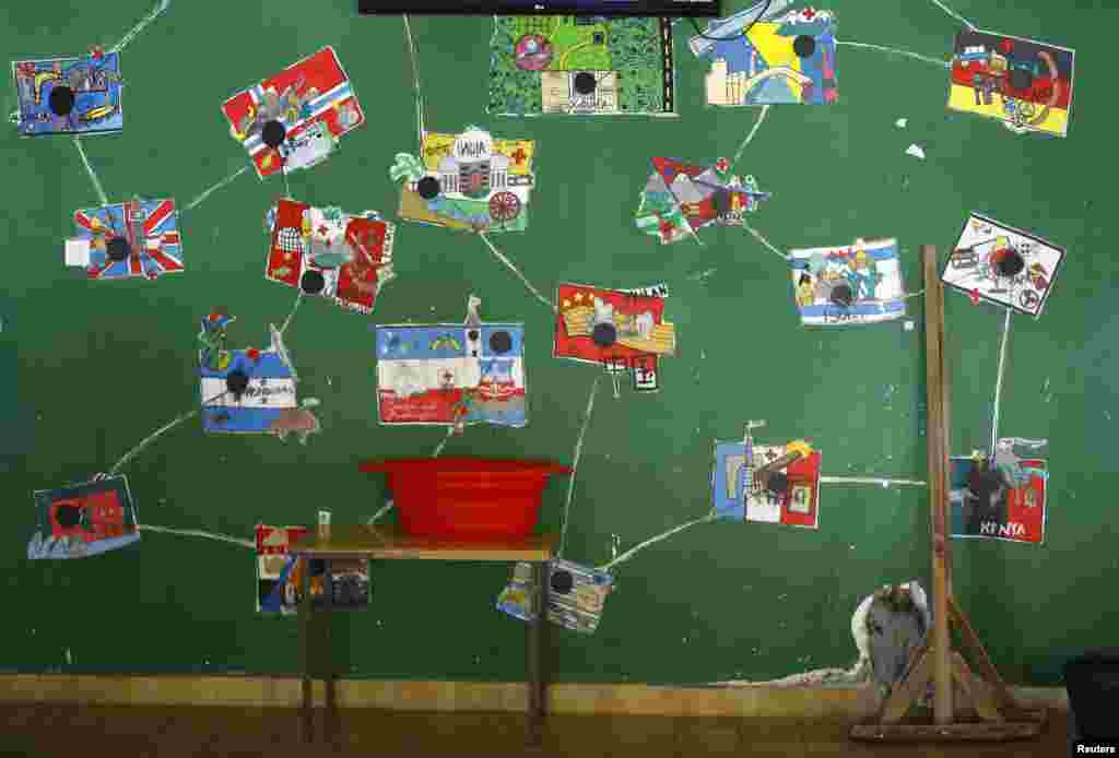 Drawings of national flags are seen in the asylum center in the village of Bogovadja near the Serbian capital Belgrade.