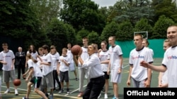 U.S. President Barack Obama at a shootaround on the White House basketball court with a delegation of Russian youths, who traveled to Washington, D.C. under the first exchange of the U.S.-Russia Bilateral Presidential Commission. (official photo - Souza)