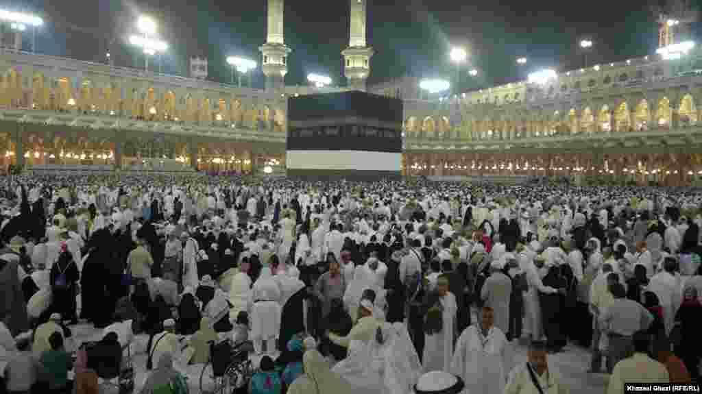 Muslim pilgrims around Kaaba in the Sacred Mosque in Mecca City