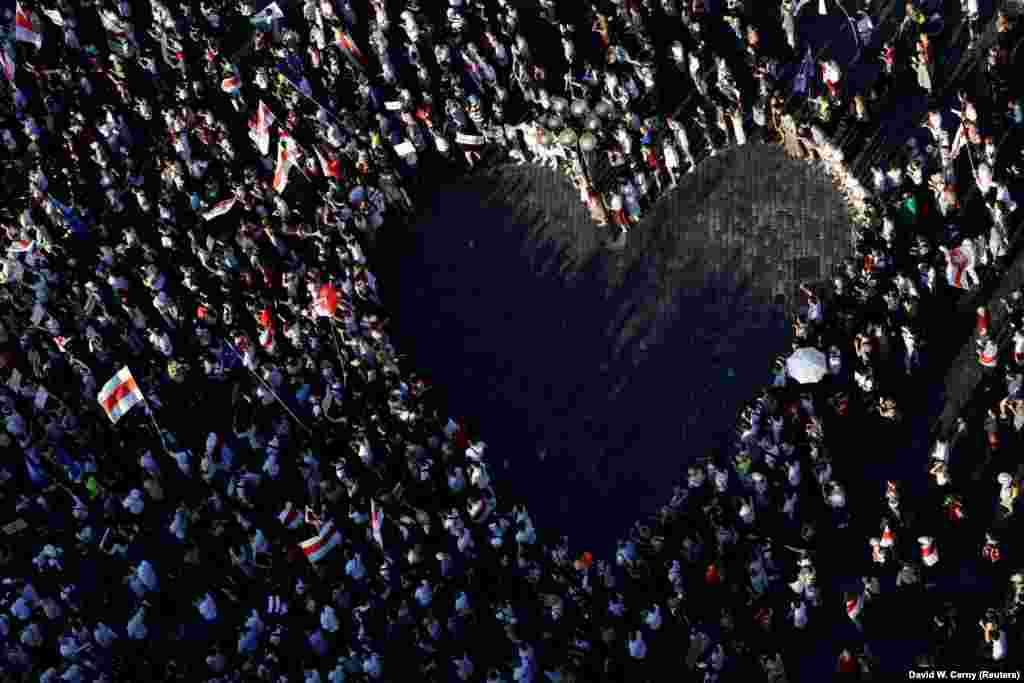 "On August 16, Belarusians living in the Czech Republic, along with their supporters, gathered to form a human ""heart"" during a Prague rally to show solidarity and support for anti-government protesters in Belarus."