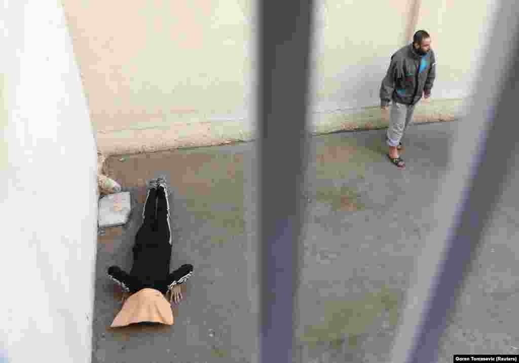 A suspect exercises in a prison in Hasaka, Syria.