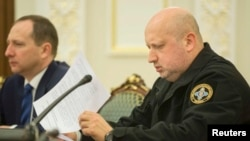 Oleksandr Turchynov (right), the chief of Ukraine's National Security and Defense Council (file photo)