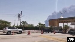 This AFPTV screen grab is from a video made on September 14, 2019, shows smoke billowing from an Aramco oil facility in Abqaiq about 60km (37 miles) southwest of Dhahran in Saudi Arabia's eastern province.