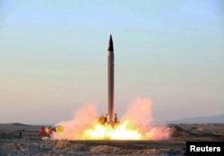An Iranian Emad rocket is test-launched at an undisclosed location in October.