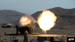 An artillery shell is fired during ongoing clashes between Afghan security forces and militants in Nangarhar.