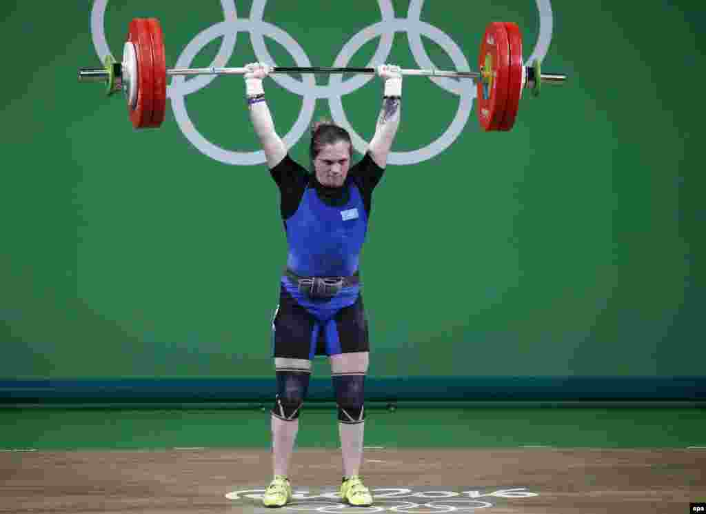 Karina Goricheva of Kazakhstan makes an attempt during the women's 63-kilogram weightlifting event.