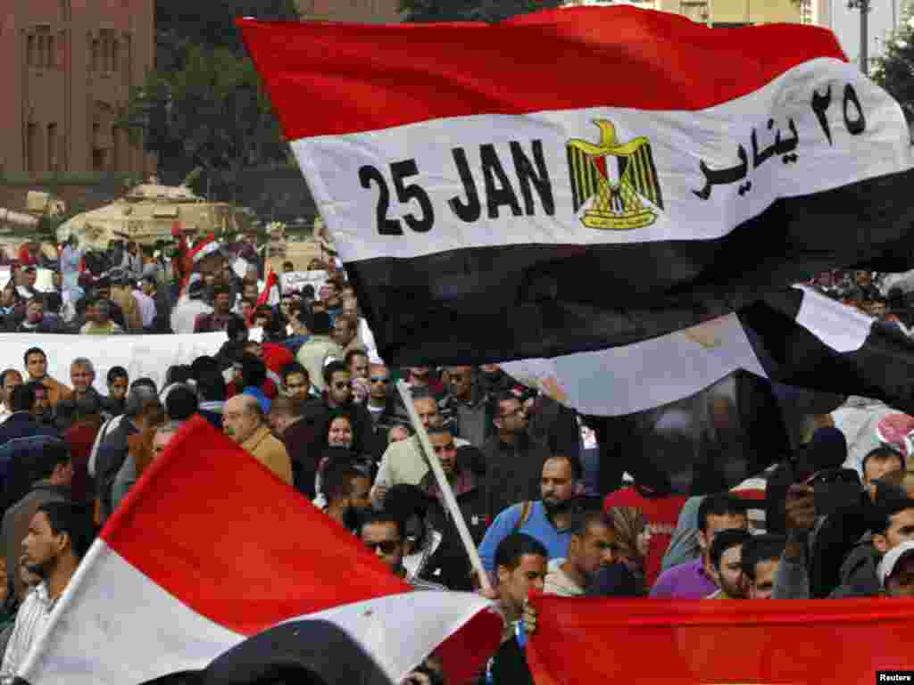 An Egyptian flag with January 25, the date the uprising started, written on it, is seen near tanks in Tahrir Square.