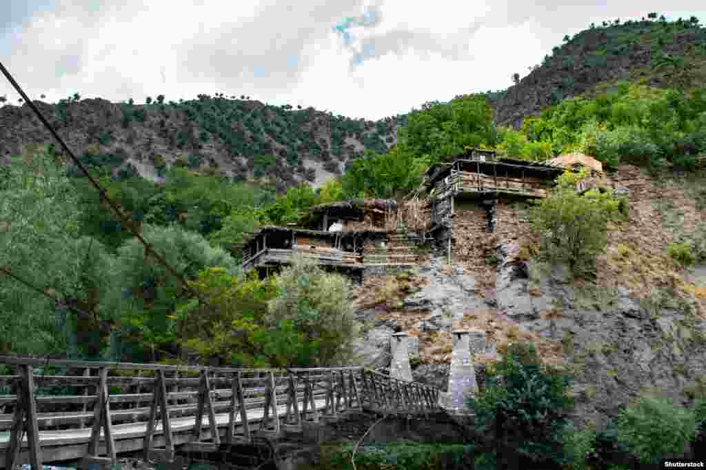Kalash houses near the frontier with Afghanistan. Across the border, the related Nuristani minority were converted to Islam in the 19th century. (Photo by Shutterstock).
