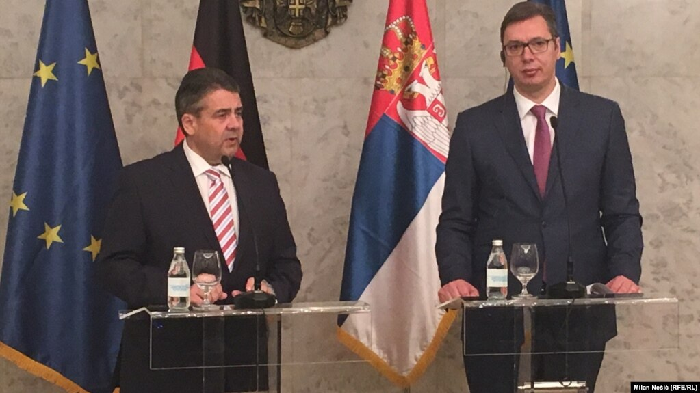 German Foreign Minister Sigmar Gabriel (left) and President-elect and Prime Minister of Serbia Aleksandar Vucic speak to the press in Belgrade on April 12.