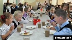 Russia - a child eats in the dining room