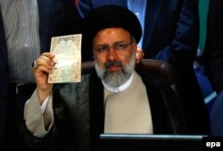 Iranian cleric Ebrahim Raisi registers as a presidential candidate
