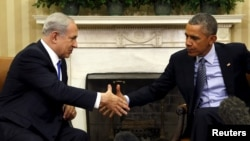 U.S. President Barack Obama and Israeli Prime Minister Benjamin Netanyahu shake hands during their meeting in the White House.
