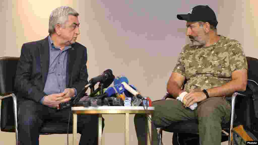 Prime Minister Serzh Sarkisian (left) and opposition leader Nikol Pashinian meeting lasted three minutes, reporters present said.