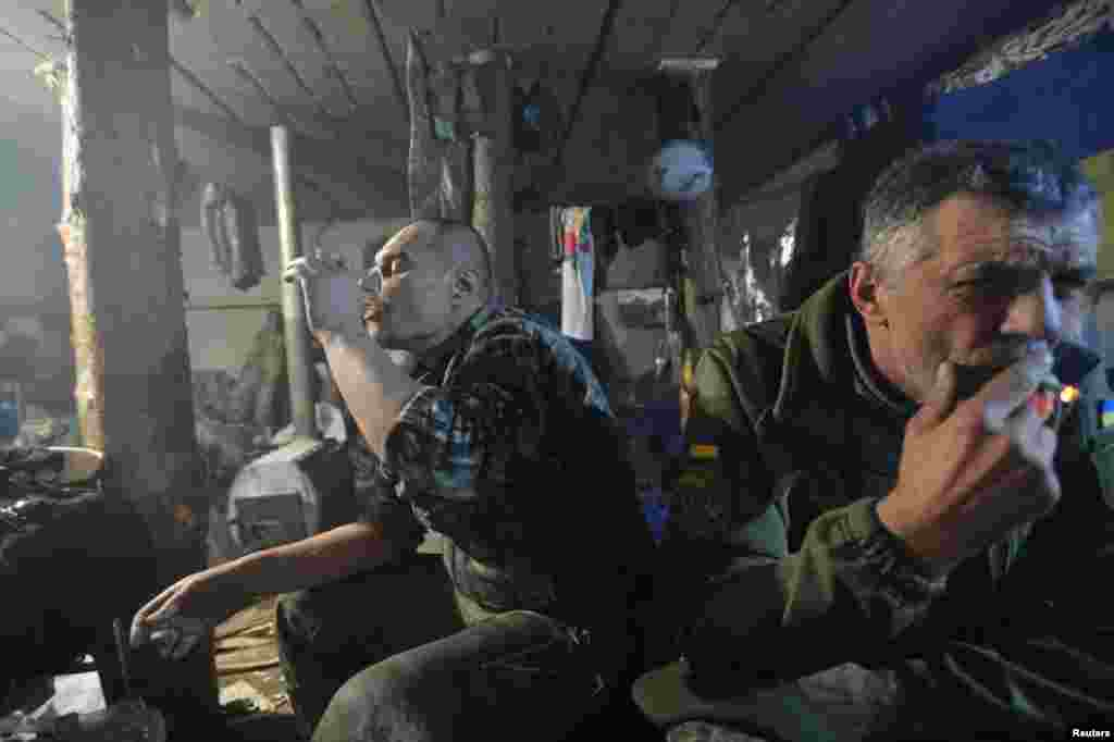 Ukrainian servicemen rest at their position on the front line near the government-held town of Avdiyivka. (Reuters/Oleksandr Klymenko)