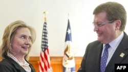 U.S. Secretary of State Hillary Clinton greets her Ukrainian counterpart, Kostiantyn Hryshchenko at a meeting in Berlin in April. (file photo)
