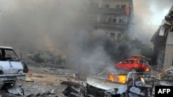 Syria -- The aftermath of a powerful car bomb explosion near the headquarters of the ruling Baath party in the centre of Damascus, 21Feb2013