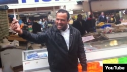 """Pakistani-born fishmonger Muhammad Shahi Nazir sings in the YouTube """"One-Pound-Fish Man"""" video from a London fish market."""