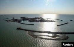 Artificial islands at the Kashagan offshore oil field in the Caspian Sea. Kazakhstan only recently restarted production in this field in October after it had been shut down when undersea pipes cracked and leaked into the surrounding water.