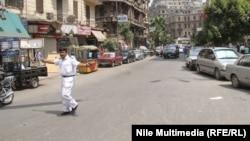 Дорожный полицейский на улице в Каире, 19-е августа