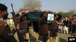 Pakistani soldiers carry the coffin of and officer killed by militants.