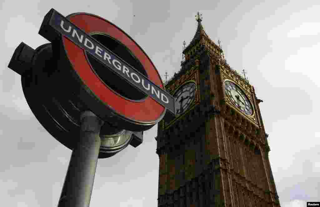 The London Underground's iconic sign appears in front of the Big Ben clock tower in central London.