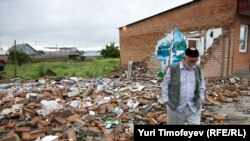A man walks by the ruins of a shop destroyed by militants in Ingushetia. Russia is struggling to quell an Islamic insurgency in the region.