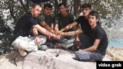 A screen grab from an extremist propaganda video showing Abdusamadov (center) and the other suspects in the attack.