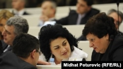 Bosnian member of parliament Milica Markovic (center)